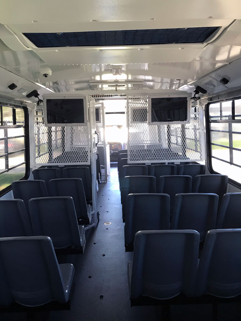 Prisoner Bus Rear-to-Front seating arrangement custom manufactured and fabricated by TWR Transport, Indiana
